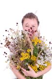 Fille avec des herbes Photographie stock libre de droits