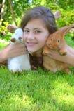 Fille avec des lapins Photos stock