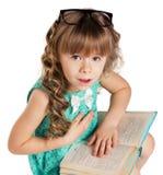 Fille avec des livres Images stock