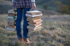 Fille avec des livres Photo stock