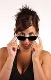 Fille avec des lunettes de soleil Photographie stock libre de droits