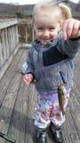 Fille avec des poissons Photographie stock libre de droits