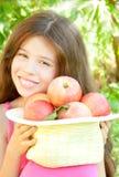 Fille avec des pommes Photo stock