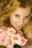 Fille avec des roses Image stock