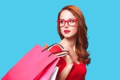 Fille avec des sacs à provisions - sally Photographie stock libre de droits