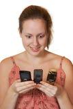 Fille avec des téléphones portables Photographie stock