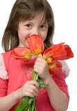 Fille avec des tulipes Photos stock