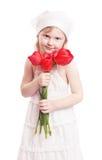 Fille avec des tulipes d'isolement sur le blanc photographie stock libre de droits