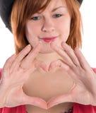 Fille avec fing en forme de coeur Photo libre de droits