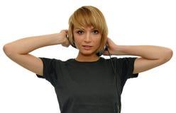 Fille avec l'écouteur Photographie stock libre de droits
