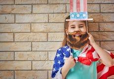 Fille avec l'indicateur américain Photographie stock