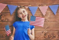 Fille avec l'indicateur américain Photos stock