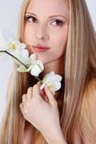Fille avec l'orchidée Images libres de droits