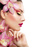 Fille avec l'orchidée Photos libres de droits