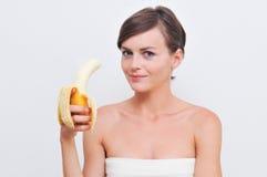 Fille avec la banane. Photographie stock