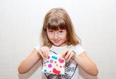Fille avec la bourse colorée Image stock
