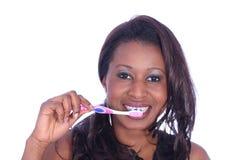 Fille avec la brosse à dents image stock