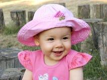 Fille avec la chaleur rose Photographie stock libre de droits