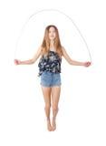 Fille avec la corde à sauter image libre de droits
