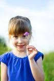 Fille avec la fleur Image libre de droits