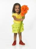 Fille avec la fleur Photo stock