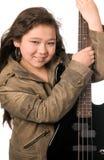 Fille avec la guitare. Photographie stock