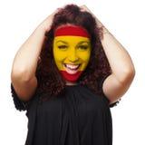 Fille avec la peinture espagnole de visage de drapeau Photos stock