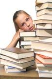 Fille avec la pile des livres Image stock
