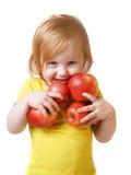 Fille avec la pomme d'isolement sur le blanc Photos libres de droits