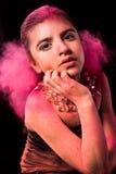 Fille avec la poudre colorée Photos libres de droits