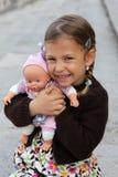 Fille avec la poupée Image libre de droits