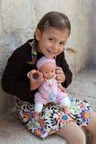 Fille avec la poupée Photographie stock