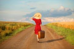 Fille avec la valise Photo libre de droits
