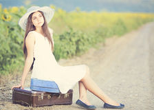 Fille avec la valise Photographie stock