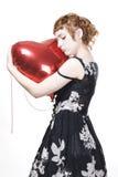 Fille avec le ballon de coeur-forme Image libre de droits