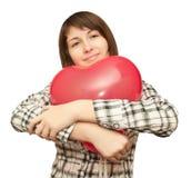 Fille avec le ballon sous forme de coeur Image libre de droits
