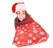 Fille avec le cadeau de Noël Photographie stock
