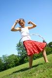 Fille avec le cercle de hula photo libre de droits