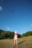 Fille avec le cerf-volant Images stock
