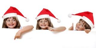 Fille avec le chapeau de Santa Image libre de droits