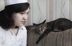 Fille avec le chat Photographie stock