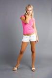 Fille avec le chemisier rose Image stock