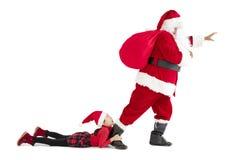 fille avec le concept de Joyeux Noël du père noël Photos libres de droits
