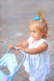 Fille avec le landau de jouet Images stock
