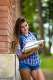 Fille avec le livre à l'université Photos libres de droits