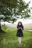 Fille avec le livre Photographie stock libre de droits