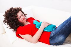 Fille avec le mal d'estomac Image libre de droits