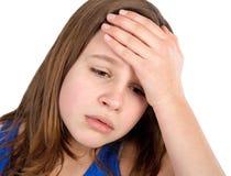 Fille avec le mal de tête Photos stock
