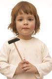Fille avec le marteau Photos stock