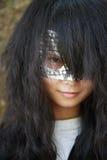 Fille avec le masque Photographie stock